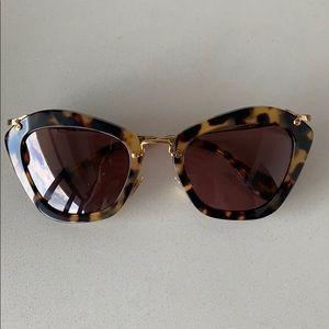 Miu Miu Noir Sunglasses. Tortoise.
